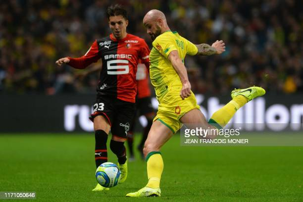 Rennes' French midfielder Adrien Hunou vies with Nantes' French defender Nicolas Pallois during the French L1 football match between FC Nantes and...