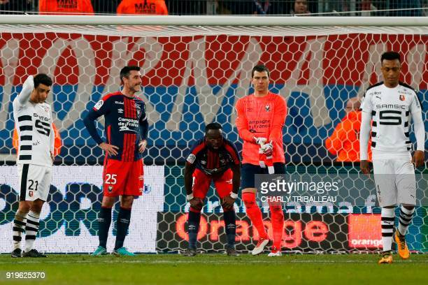 Rennes' French midfielder Benjamin Andre Caen's French midfielder Julien Feret Caen's Ivorian midfielder Ismael Diomande react at the end of the...