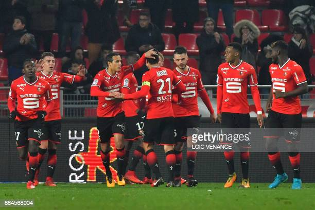 Rennes' French midfielder Benjamin Andre celebrates with teammates after scoring during the French L1 football match Rennes vs Amiens on December 2...