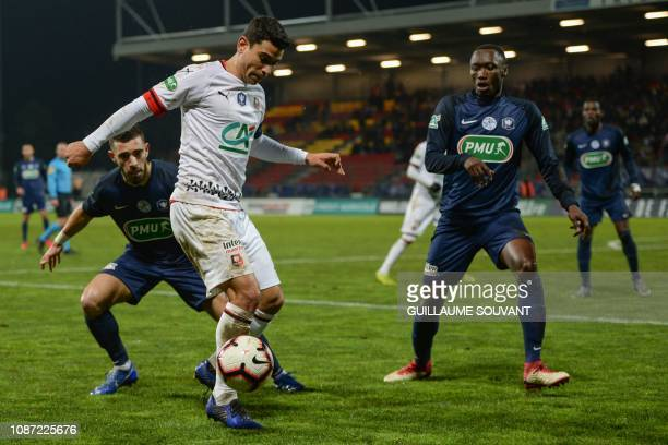 Rennes' French midfielder Benjamin Andre fights for the ball against SaintPryvéSaintHilaire's French defender Hugo Vargas Rios and...