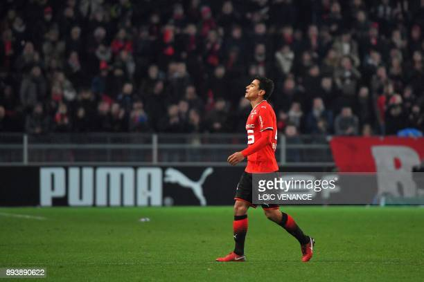 Rennes' French midfielder Benjamin Andre leaves the field after receiving a red card during the French L1 football match between Rennes and Paris...