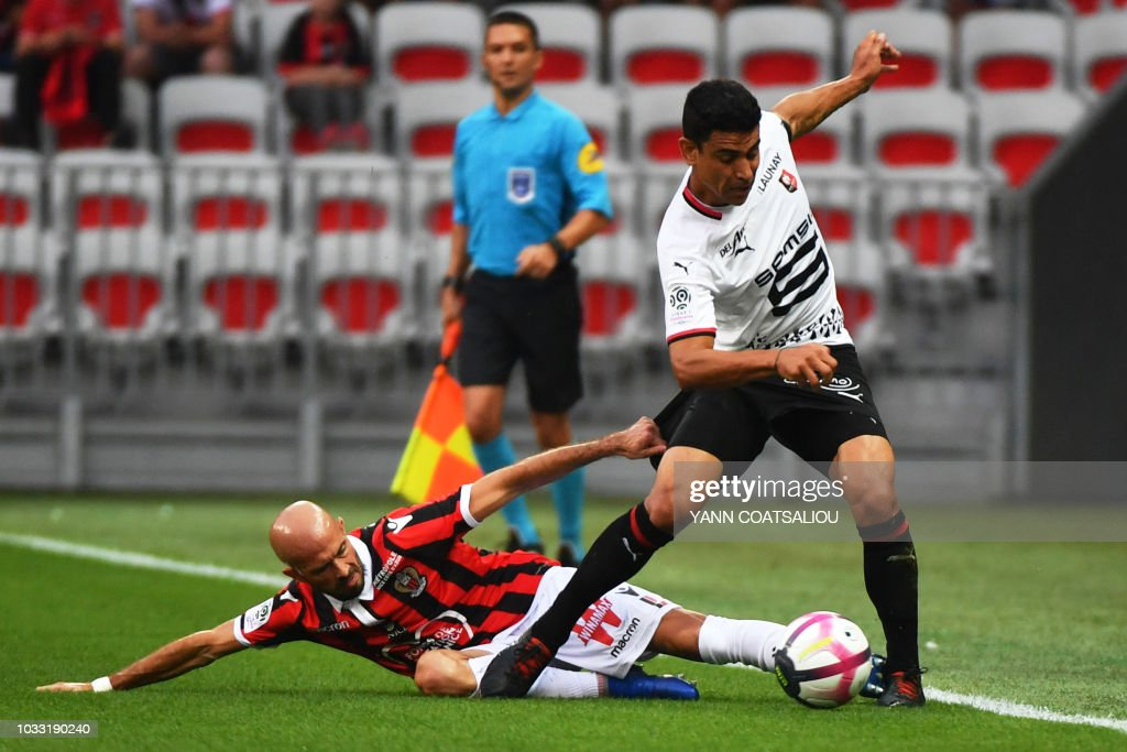 Rennes' French midfielder Benjamin Andre (R) vies for the ball with Nice's French defender Christophe Jallet during the French L1 football match between Nice (OGCN) and Rennes (SRFC) on September 14, 2018, at the Allianz Riviera stadium in Nice, southern France.