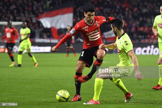 Rennes' French midfielder Benjamin Andre vies with Angers' French defender Yoann Andreu during the French L1 football match between Rennes and Angers...
