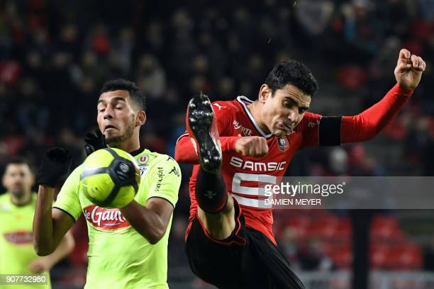 Rennes' French midfielder Benjamin Andre vies with Angers' French midfielder Angelo Fulgini during the French L1 football match between Rennes and...