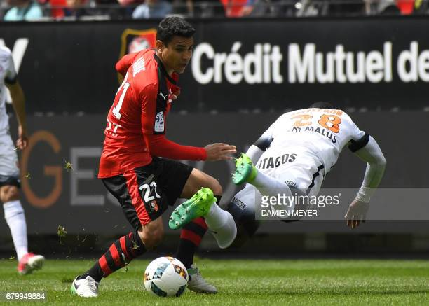 Rennes' French midfielder Benjamin Andre vies with Montpellier's French midfielder Stephane Sessegnon during the French L1 football match Rennes...