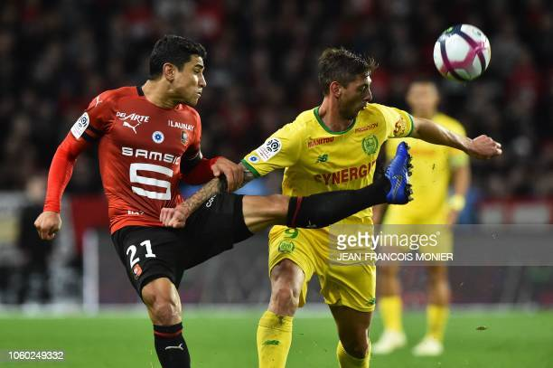 Rennes' French midfielder Benjamin Andre vies with Nantes' Argentine forward Emiliano Sala during the French L1 Football match between Rennes and...