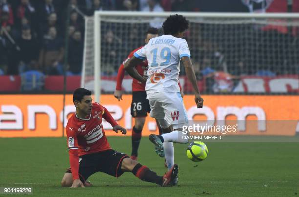 Rennes' French midfielder Benjamin Andre vies with Olympique Marseille's Brazilian midfielder Luiz Gustavo during the French L1 football match Rennes...