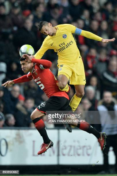 Rennes' French midfielder Benjamin Andre vies with Paris SaintGermain's Brazilian defender Marquinhos during the French L1 football match between...