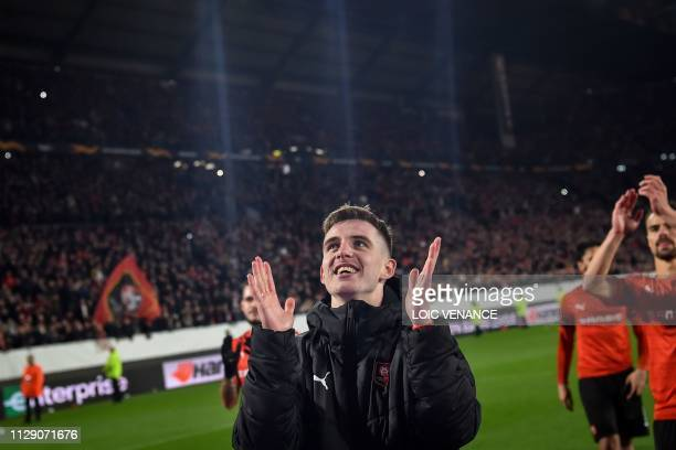 Rennes' French midfielder Benjamin Bourigeaud celebrates their 3-1 victory over Arsenal at the end of the UEFA Europa League round of 16 first leg...