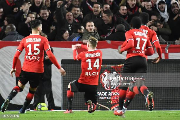 Rennes' French midfielder Benjamin Bourigeaud celebrates with teammates and supporters after scoring a goal during the French L1 football match...