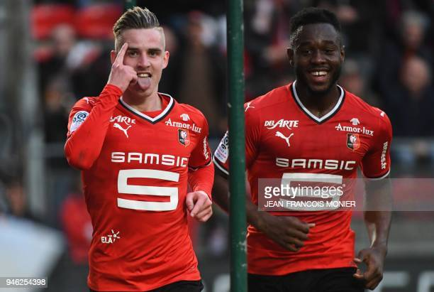 Rennes' French midfielder Benjamin Bourigeaud celebrates with teammate Rennes' French defender Joris Gnagnon after scoring a goal during the French...