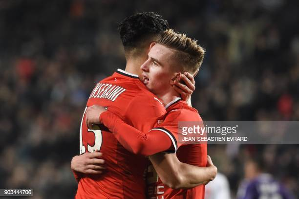 Rennes' French midfielder Benjamin Bourigeaud is congratulated by his teammate Rennes' Algerian defender Ramy Bensebaini after scoring a goal during...