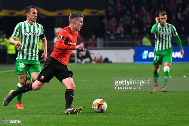 Rennes' French midfielder Benjamin Bourigeaud vies for the ball with Real Betis' Spanish defender Andres Guardado during the UEFA Europa League round...