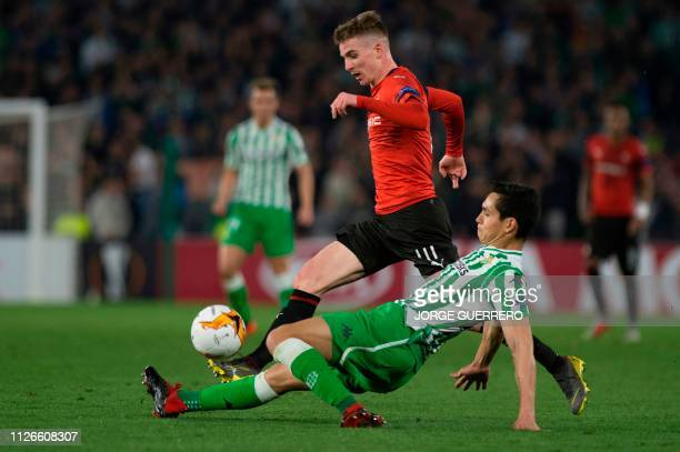 Rennes' French midfielder Benjamin Bourigeaud vies for the ball with Real Betis' Algerian defender Aissa Mandi during the UEFA Europa League round of...