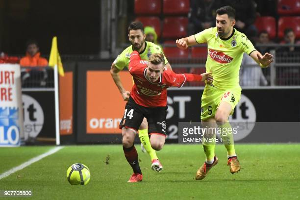 Rennes' French midfielder Benjamin Bourigeaud vies with Angers' French midfielder Thomas Mangani during the French L1 football match between Rennes...