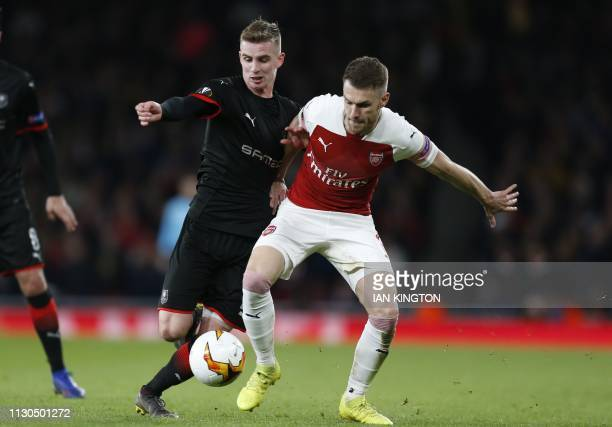 Rennes' French midfielder Benjamin Bourigeaud vies with Arsenal's Welsh midfielder Aaron Ramsey during the UEFA Europa League Round of 16 second leg...