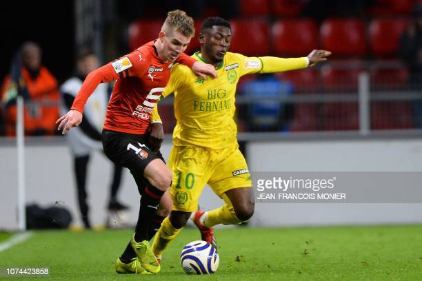 Rennes' French midfielder Benjamin Bourigeaud vies with Nantes' Ghanaian forward Abdul Majeed Waris during the French League Cup round of 16 football...