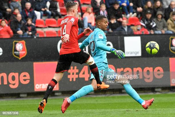 Rennes' French midfielder Benjamin Bourigeaud vies with Toulouse's French goalkeeper Alban Lafont during the French L1 football match Rennes vs...