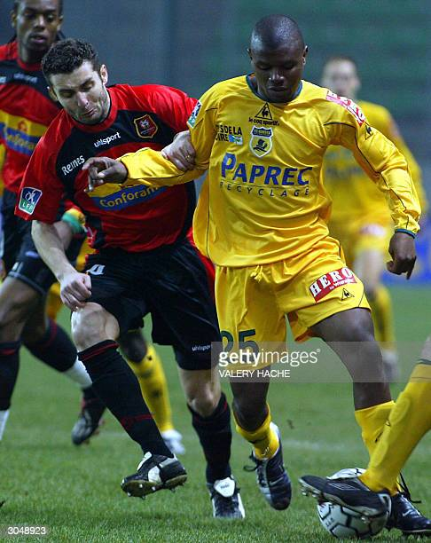 Rennes French midfielder Cedric Barbosa vies with Nantes Cameroonian defender Jean Hugues Bilayi Ateba, during their French L1 match 6 March 2004, at...