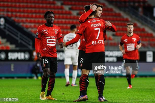 Rennes' French midfielder Clement Garenier hugs Rennes' French forward Martin Terrier after scoring a goal during the French L1 football match...