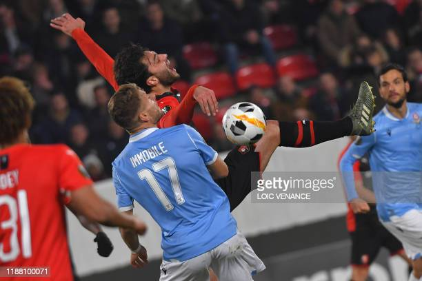 Rennes' French midfielder Clement Grenier is challenged by SS Lazio's forward Ciro Immobile, during the UEFA Europa League Group E football match...
