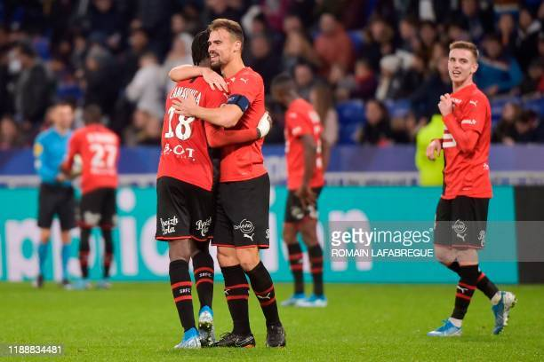 Rennes' French midfielder Eduardo Camavinga celebrates with Rennes' French defender Damien Da Silva after scoring a goal during the French L1...