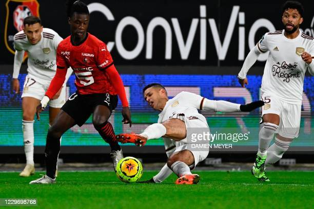 Rennes' French midfielder Eduardo Camavinga fights for the ball with Bordeaux's French forward Hatem Ben Arfa during the French L1 football match...