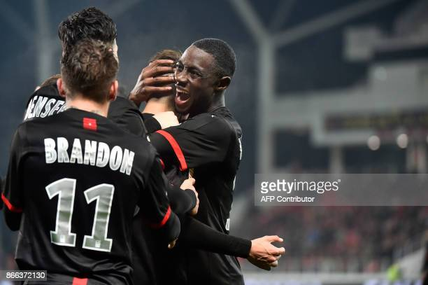 Rennes' French midfielder James Lea Siliki celebrates after scoring a goal during the French League Cup round of 16 football match between Dijon and...