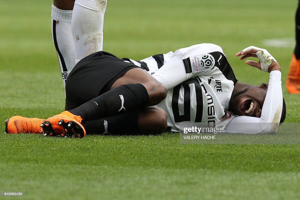 Rennes' French midfielder James Lea Siliki reacts on the ground during the French L1 football match Nice vs Rennes on april 8, 2018 at the 'Allianz Riviera' stadium in Nice, southeastern France. /
