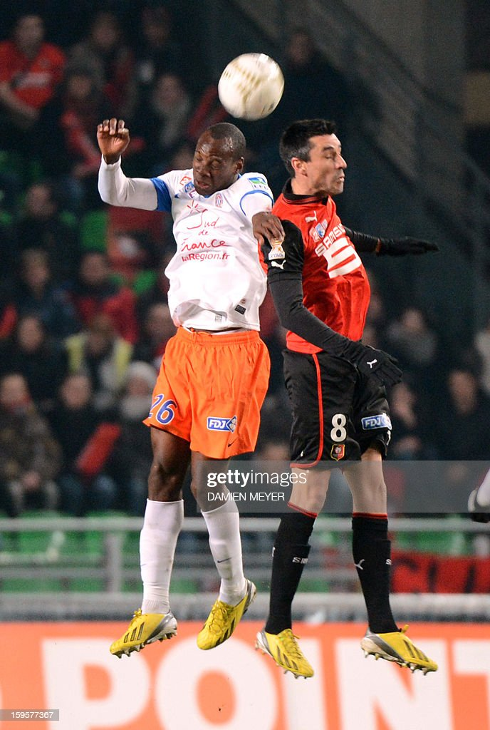 Rennes' French midfielder Julien Feret (R) fights for the ball with Montpellier's French defender Bryan Dabo during a French League Cup semifinal football match Rennes against Montpellier on January 16, 2013 at the route de Lorient stadium in Rennes, western France.