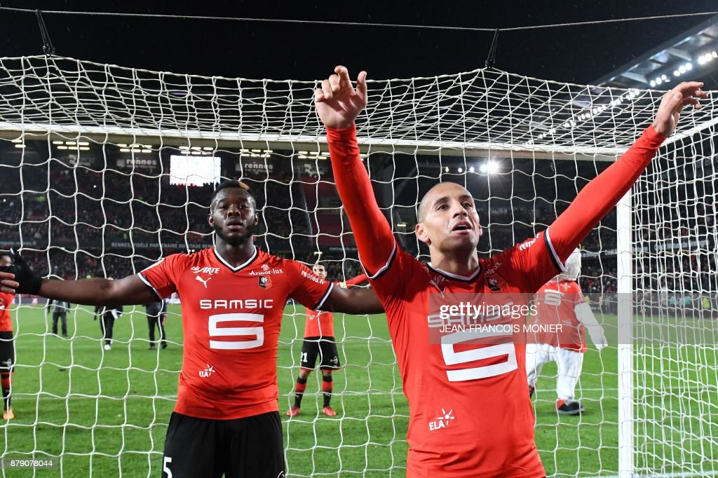 Rennes' French midfielder Wahbi Khazri (R) and teammate Rennes' French defender Joris Gnagnon (L) react after victory in the French L1 football match between Stade Rennais (Stade Resnais FC) and Nantes (FC Nantes)at The Roazhon Park, in Rennes, northwestern France on November 25, 2017. /