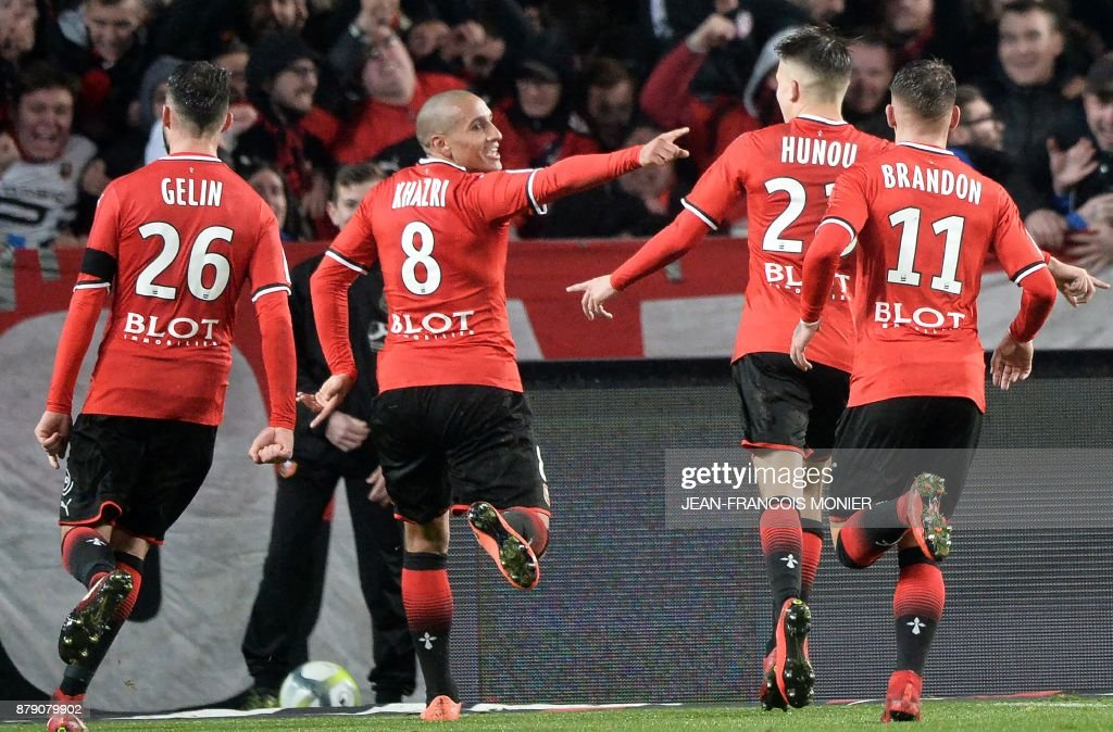 Rennes' French midfielder Wahbi Khazri (2L) reacts after scoring his second goal during the French L1 football match between Stade Rennais (Stade Resnais FC) and Nantes (FC Nantes)at The Roazhon Park, in Rennes, northwestern France on November 25, 2017. /