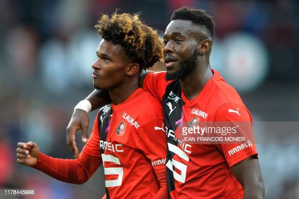 Rennes' French midfielder Yann Gboho and Rennes' French defender Joris Gnagnon celebrate their victory at the end of the French L1 football match...