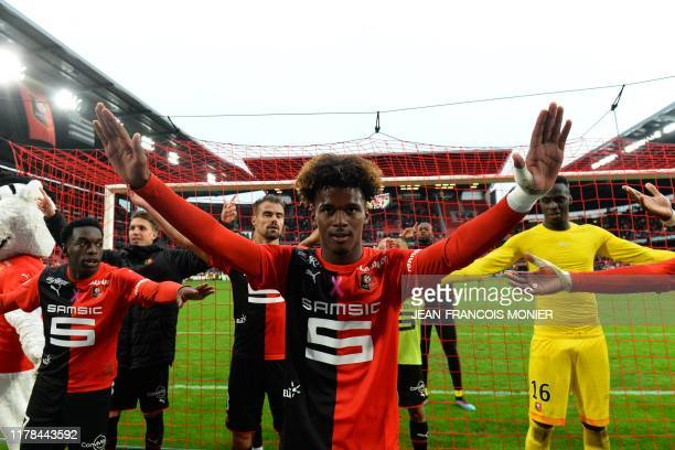 Rennes' French midfielder Yann Gboho celebrates with teammates his team's third goal and their victory at the end of the French L1 football match...