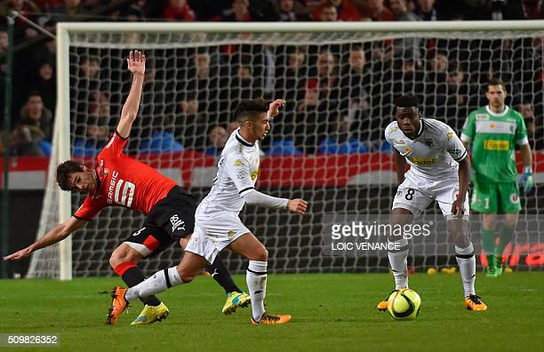 Rennes' French midfielder Yoann Gourcuff fights for the ball with Angers' Algerian defender Said Benrahma during the French L1 football match Rennes...