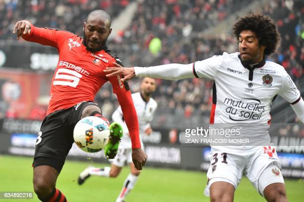 Rennes' Ivorian forward Giovanni Sio vies for the ball with Nice's Brazilian defender Dante during the French L1 football match between Rennes and...