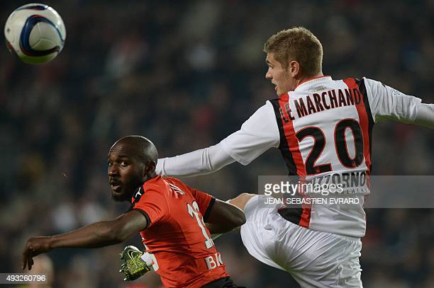 Rennes' Ivorian forward Giovanni Sio vies with Nice's French defender Maxime Le Marchand during the French L1 football match between Rennes and Nice...