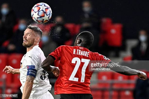 Rennes' Malian defender Hamari Traore fights for the ball with FK Krasnodar's Swedish forward Marcus Berg during the UEFA Europa League Group E...