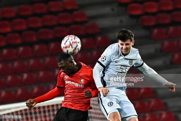Rennes' Malian defender Hamari Traore fights for the ball with Chelsea's English midfielder Mason Mount during the UEFA Champions League Group E...