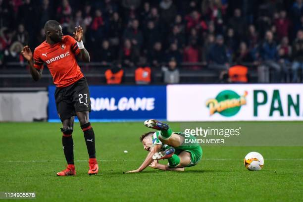 Rennes' Malian defender Hamari Traore gestures after tackling a Real Betis' Spanish midfielder Sergio Canales during the UEFA Europa League round of...