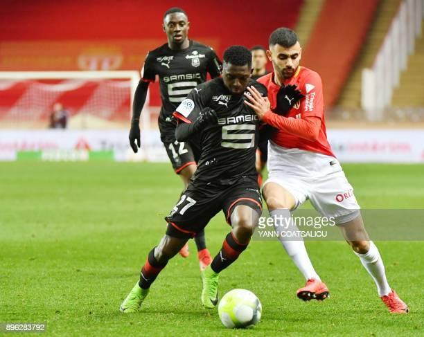 Rennes' Malian defender Hamari Traore vies with Monaco's French midfielder Rachid Ghezzal during the french L1 football match Monaco vs Stade Rennais...