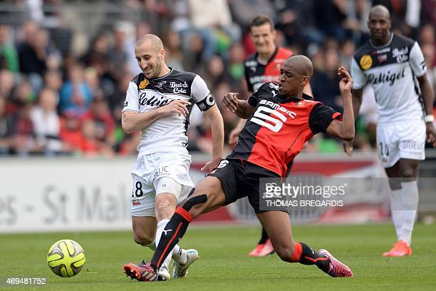 Rennes' midfileder Gelson Fernandes vies with Guingamp' midfileder Lionel Mathis during the French L1 football match between Rennes and Guingamp on...