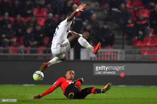 Rennes' Mozambican defender Mexer vies with Amiens' Senegalese forward Moussa Konate during the French Ligue 1 football match between Rennes and...