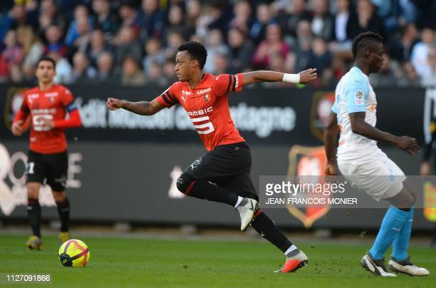 Rennes' Mozambican defender Mexer vies with Marseille's Italian forward Mario Balotelli during the French L1 Football match between Rennes and...