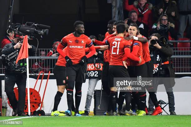Rennes' players celebrate after scoring a goal during the UEFA Europa League round of 32 firstleg football match between Rennes and Real Betis at the...