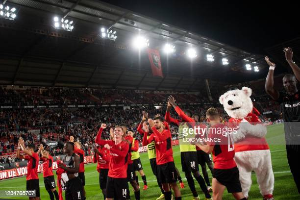Rennes' players celebrate after winning in the Conference Europa league football match between Rennes and Rosenborg at the Rohazon Park Stadium in...