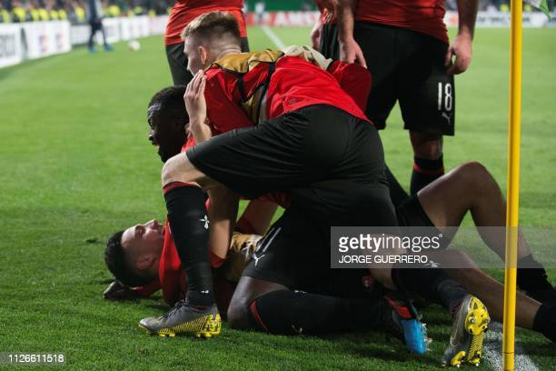 Rennes' players celebrate after winning the UEFA Europa League round of 32 second leg football match between Real Betis and Rennes at the Benito...