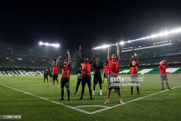 TOPSHOT Rennes' players celebrate after winning the UEFA Europa League round of 32 second leg football match between Real Betis and Rennes at the...
