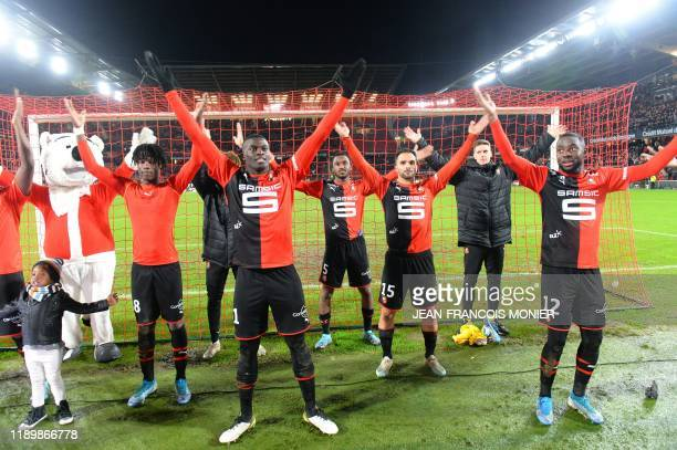 Rennes' players celebrate at the end of the French L1 football match between Stade Rennais Football Club and FC Girondins de Bordeaux at the Roazhon...