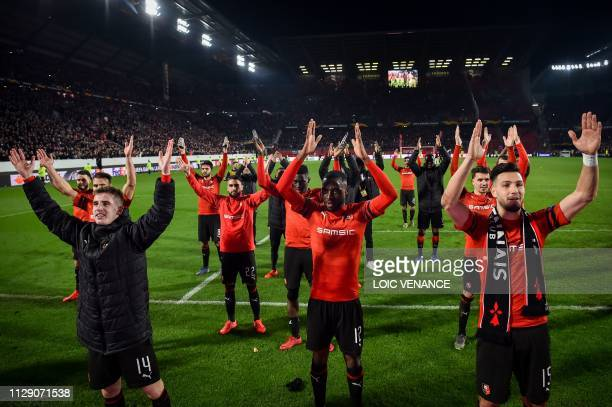 Rennes' players celebrate their 31 victory over Arsenal at the end of the UEFA Europa League round of 16 first leg football match between Stade...